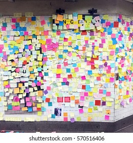 Sticky post-it notes on wall in Union Square subway station in NYC after election results