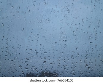 sticky raindrops on clear glass