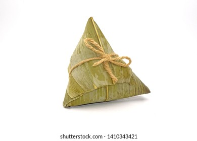 Sticky rice dumpling or Zongzi (Pyramid-shaped dumpling made by wrapping glutinious rice in bamboo leaves) for Chinese Boat dragon festival (5th Lunar month, Duanwu festvial). Isolated on white