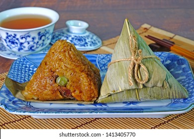 Sticky rice dumpling or Zongzi (Pyramid-shaped dumpling made by wrapping glutinious rice in bamboo leaves) Tradition food for Chinese Boat dragon festival (5th Lunar month festvial, Duanwu festival)