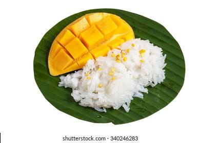 Sticky rice mango, thai dessert on banana leaf isolated on white