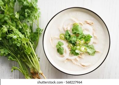 sticky rice porridge with chicken and coriander