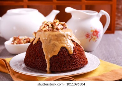 Sticky toffee pudding with caramel sauce and nuts