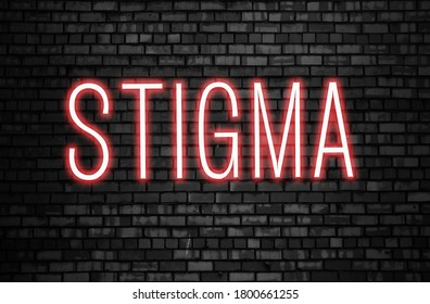 Stigma glowing neon word on black brick wall. Tolerance concept.