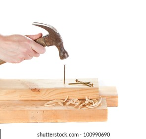 Stiking a nail with a hammer isolated on white backgroun