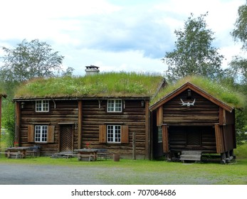 STIKLESTAD, NORWAY - JULY 4, 2012. Historical timber buildings in Stiklestad National Cultural Center in Norway. Building on the right is Adalsvollsburet - the oldest building in Stiklestad from 1650.