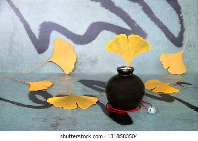 Stil life with ginkgo leaf on abstract background in chinese style