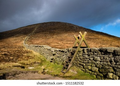 Stile over the Mourne Stone Wall at Hare's Gap, Mourne Mountains, County Down, Northern Ireland.