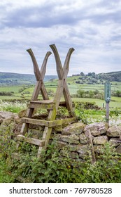 A stile/Steps over a dry stone wall.