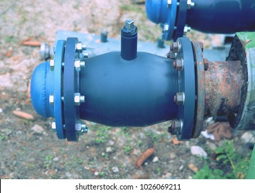 The still balancing ball valve with socket cover. Flanges with silver screws and nuts. New valves on old pipes.