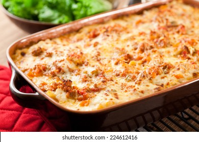 Still bubbling hot from the oven. This lasagna was made with layers of slow simmered ragu, bechamel sauce, parmesan cheese and lasagna noodles. Fresh salad in the background.