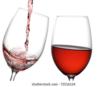 Still and flowing red wine glasses