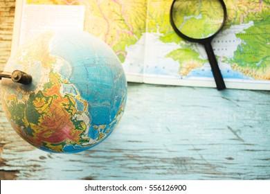 Still globe, magnifier map backround