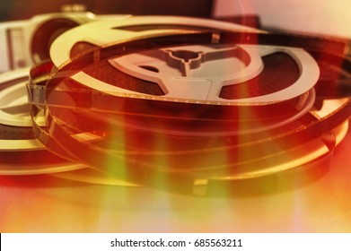Still life of 8mm cine film reels with flame background
