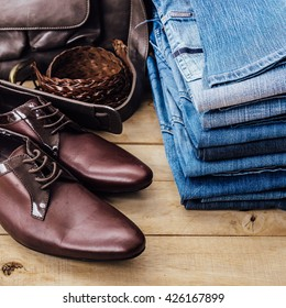 still life of accessories leather shoes ,billfold ,leather bags, belts on wooden background