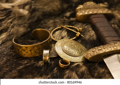 Still life with ancient scandinavian jewels and sword on a fur