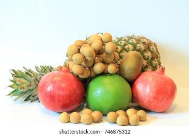 Still life of appetizing fruit, pineapple, pomegranate, lemon, apple, pear, kiwi, grapefruit, longan, long-kong.