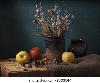 still life with apples and dried flowers