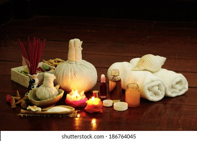 Still life art photography on spa concept with oil treatment herbal massage balls exfoliation salt scrub and spa accessories