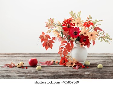 Still life with a autumn flowers and leaves