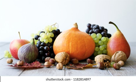 Still life of autumn fruits and vegetables. White wooden background, top view