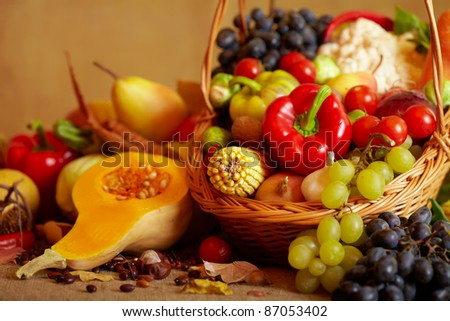 Still life with autumn vegetables and fruits on burlap background