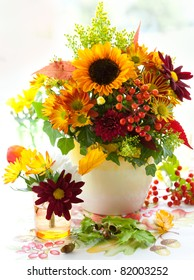 still life with autumnal flowers and berries