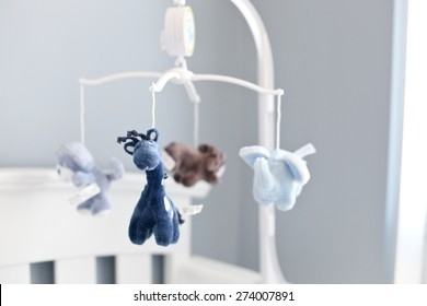 Still Life of Baby Mobile with Blue Stuffed Animals