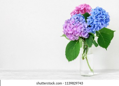 Still life with a beautiful bouquet of pink and blue hydrangea flowers. holiday or wedding background with copy space. nature concept