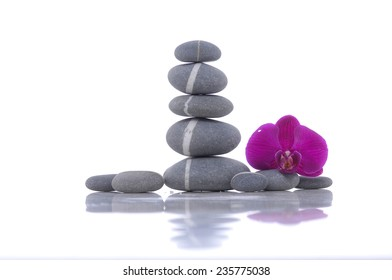 Still life with Beautiful red orchid and stacked stones
