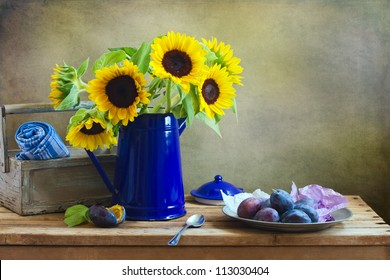 Still life with beautiful sunflower bouquet on wooden tabletop against grunge wall