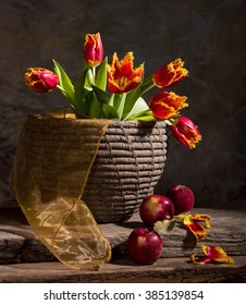 Still life with beautiful tulips and red apples