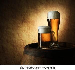 Still Life of beer and barrel on a grange background