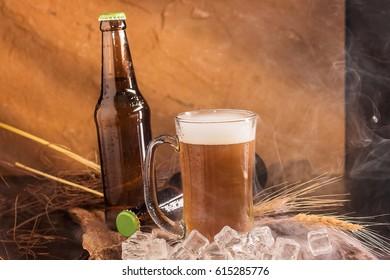 Still life with beer mug, bottle, grain on wooden