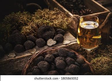 Still life of black truffle mushroom with a gluss of white wine
