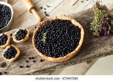 Still life of blueberry pie on wooden boards