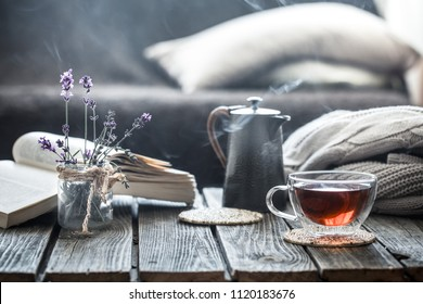 still life book and a cup of tea in the living room on a wooden table, the concept of coziness and interior - Shutterstock ID 1120183676