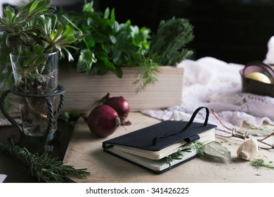 Still life with book and kitchen herbs
