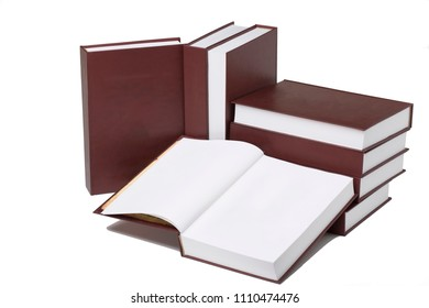 Still life of books with white clear sheets. These books are isolated in a white background.
