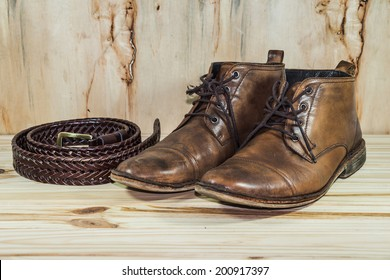 still life with boots and belt
