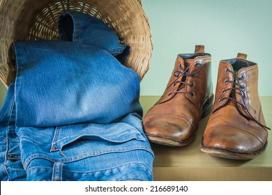 still life with boots and jeans