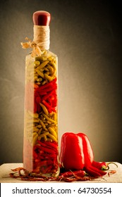 Still life of bottle with oil and chili. Paprika
