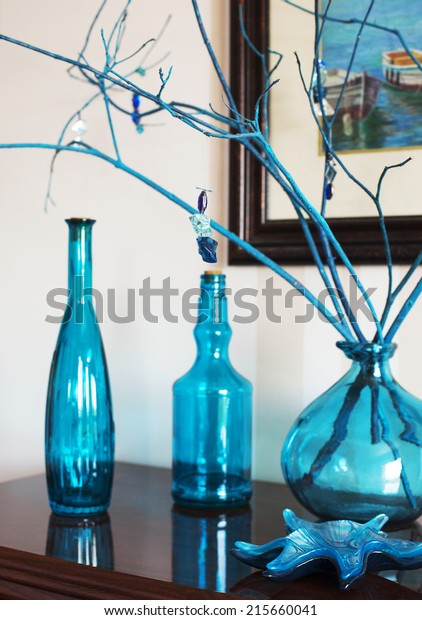 Still life with bottles in blue tones. Interior decoration object