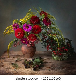 Still life with bouquet of garden flowers and forest fruits