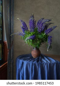 Still life with a bouquet of lupines
