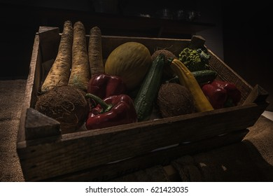 Still life of a box with vegetables and fruit