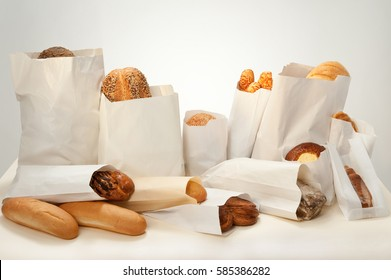 Still life. Bread with different additives with seeds, sesame seeds, cheese, cottage cheese, poppy seeds packed in paper bags.