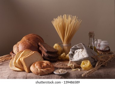 still life with bread, pasta and wheat