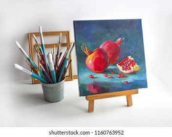 Still life with brushes, frames and easel and painting