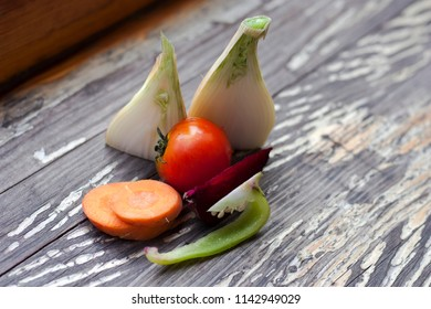 Still life with Bulgarian pepper, tomato, beetroot, carrot, onion slices